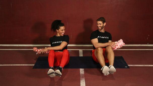 PHOTO: Engaged trainers Bree Branker and CJ Koegel demonstrate a couples workout at Chelsea Piers in New York City. (ABC)