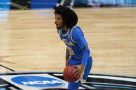 UCLA guard Tyger Campbell (10) drives up court during the first half of a men's Final Four NCAA college basketball tournament semifinal game against Gonzaga, Saturday, April 3, 2021, at Lucas Oil Stadium in Indianapolis. (AP Photo/Michael Conroy)
