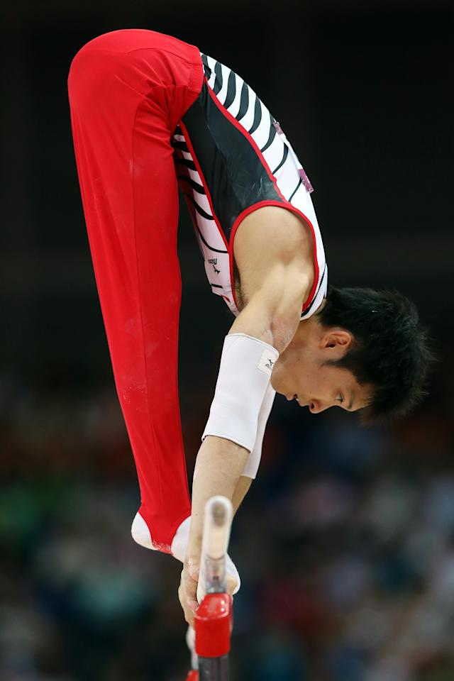 LONDON, ENGLAND - JULY 30: Kazuhito Tanaka of Japan competes on the parallel bars in the Artistic Gymnastics Men's Team final on Day 3 of the London 2012 Olympic Games at North Greenwich Arena on July 30, 2012 in London, England. (Photo by Streeter Lecka/Getty Images)