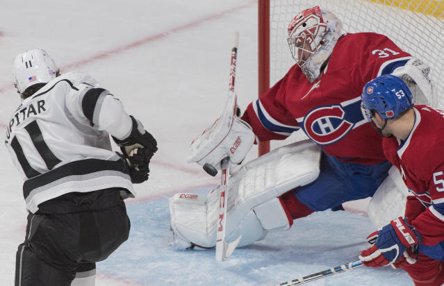 Los Angeles Kings' Anze Kopitar shoots on Montreal Canadiens goaltender Carey Price as Canadiens' Victor Mete defends during the third period of an NHL hockey game Saturday, Nov. 9, 2019, in Montreal. (Graham Hughes/The Canadian Press via AP)