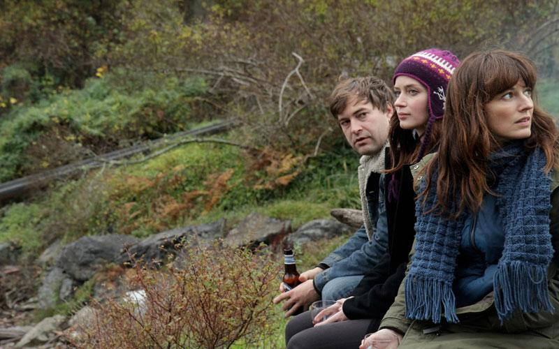"""This film image released by IFC Films shows, from left, Mark Duplass, Emily Blunt and Rosemarie DeWitt in a scene from """"Your Sister's Sister."""" (AP Photo/IFC Films, Steven Schardt)"""