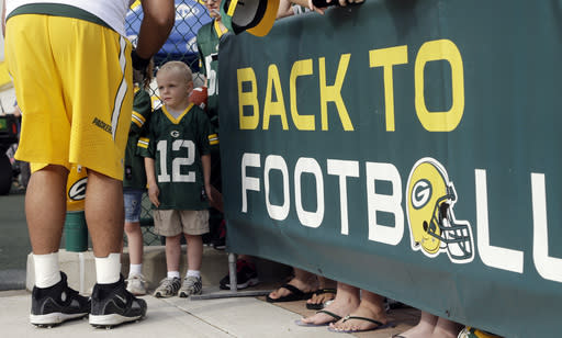 Owen Hanbschke, 4, of Appleton waits to get an autograph from Green Bay Packers' Derek Sherrod during NFL football training camp Saturday, July 26, 2014, in Green Bay, Wis. (AP Photo/Morry Gash)