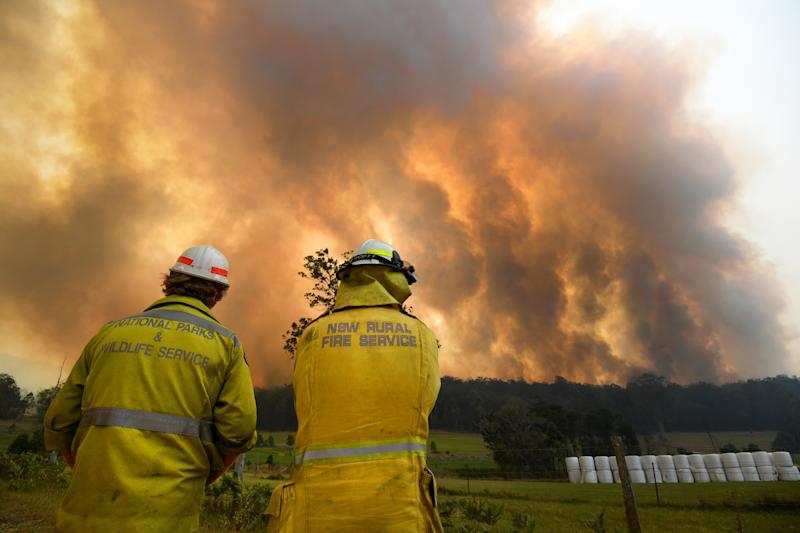 Smoke from a large bushfire is seen outside Nana Glen, near Coffs Harbour, Tuesday, November 12, 2019. There are more than 50 fires burning around the state, with about half of those uncontained. (AAP Image/Dan Peled) NO ARCHIVING