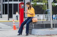 <p>'70s-style bell bottoms are making a serious comeback. Wearing them is one of the easiest ways to create a polished look, paired with either a cable knit, tank top, breezy blouse, or t-shirt. Channel your inner bohemian queen and complete them with a clog or platform boot. A lot of the styles come in a stretch denim, too, so if rigid denim's just not for you, you're in luck.</p>