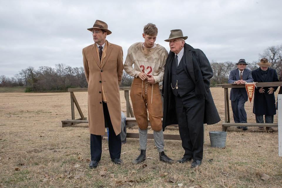 """Rusty Russell (far left, Luke Wilson, far left), Snoggs (Jacob Lofland) and Doc Hall (Martin Sheen) discuss the next play in the football drama """"12 Mighty Orphans,"""" about an underdog team of scrawny orphaned Texan boys who become a winning squad."""