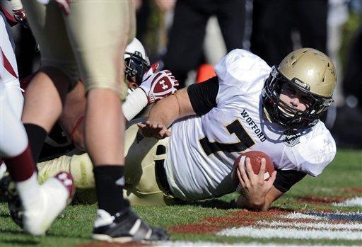 Wofford fullback Eric Breitenstein (7) scores a touchdown late in the first half of an NCAA college football game against South Carolina, Saturday, Nov. 17, 2012, in Columbia, S.C. (AP Photo/Stephen Morton)