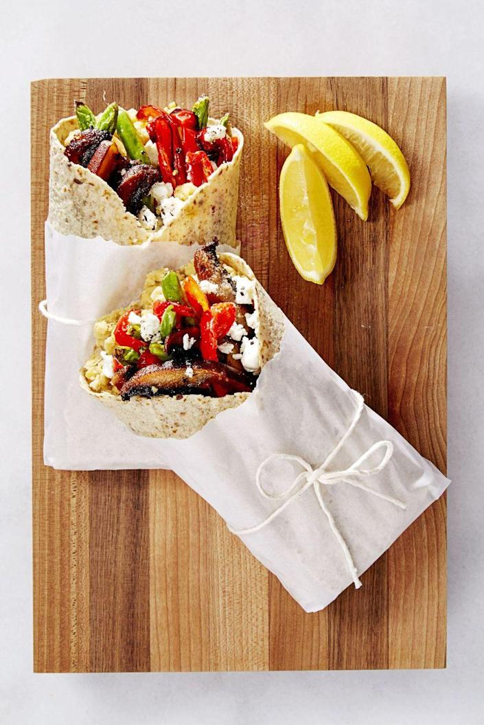 """<p>These veggie wraps with mushrooms, red pepper, chickpeas, and goat cheese are easy to make and take on the go. </p><p><u><em>Get the recipe from <a href=""""https://www.goodhousekeeping.com/food-recipes/easy/a36678/veggie-wraps-with-goat-cheese/"""" rel=""""nofollow noopener"""" target=""""_blank"""" data-ylk=""""slk:Good Housekeeping"""" class=""""link rapid-noclick-resp"""">Good Housekeeping</a>. </em></u></p>"""