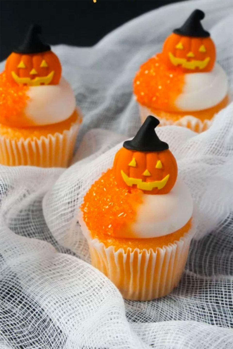 """<p>The combination of vanilla and orange flavors make these cupcakes scarily sweet.</p><p><strong>Get the recipe at <a href=""""http://thesoccermomblog.com/2016/09/17/orange-halloween-cupcakes/"""" rel=""""nofollow noopener"""" target=""""_blank"""" data-ylk=""""slk:The Soccer Mom Blog"""" class=""""link rapid-noclick-resp"""">The Soccer Mom Blog</a>. </strong></p>"""