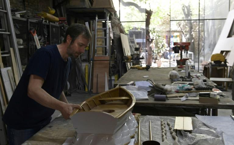 Erlich checks an unfinished piece at his studio in Buenos Aires