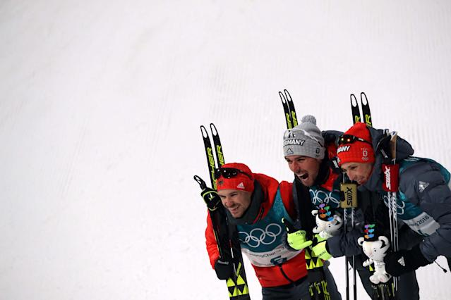 Nordic Combined Events - Pyeongchang 2018 Winter Olympics - Men's Individual 10 km Final - Alpensia Cross-Country Skiing Centre - Pyeongchang, South Korea - February 20, 2018 - Eric Frenzel of Germany, Johannes Rydzek of Germany and Fabian Riessle of Germany celebrate during the victory ceremony. REUTERS/Carlos Barria