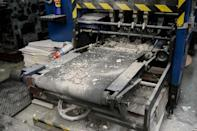 The paper's printing press was damaged by a group of masked men who stormed into its printing plant