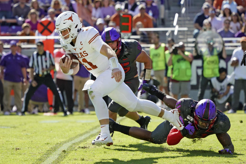 Texas quarterback Sam Ehlinger (11) breaks away on a run in the first half of an NCAA college football game against TCU in Fort Worth, Texas, Saturday, Oct. 26, 2019. (AP Photo/Louis DeLuca)