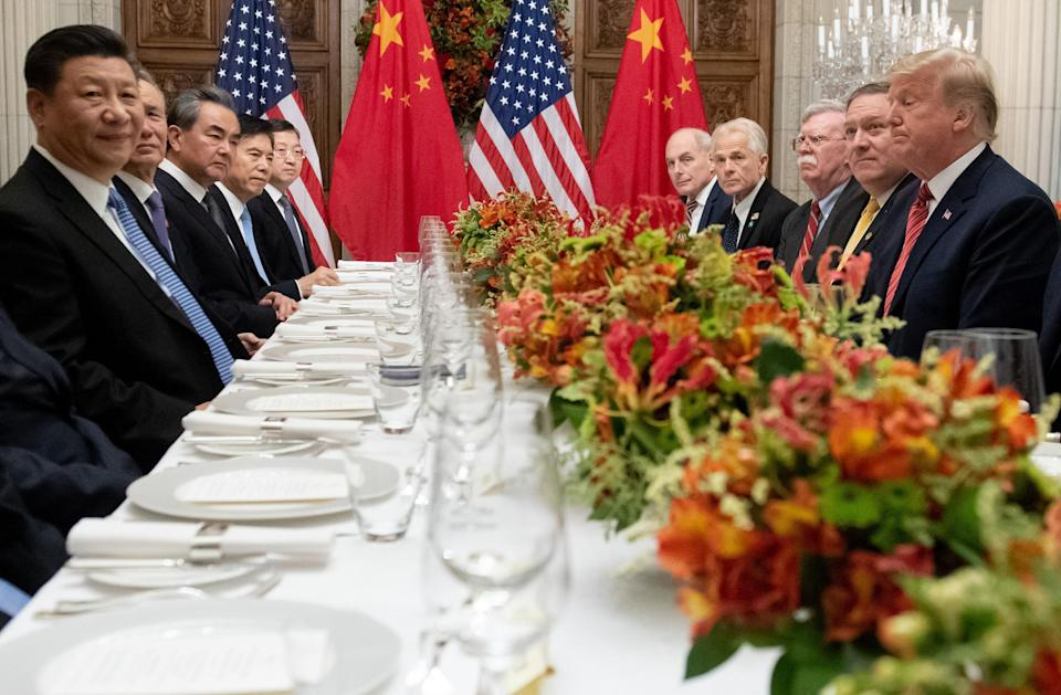 Presidents Trump and Xi, with their delegations, at dinner in Buenos Aries on Dec. 1. Photo: Getty Images