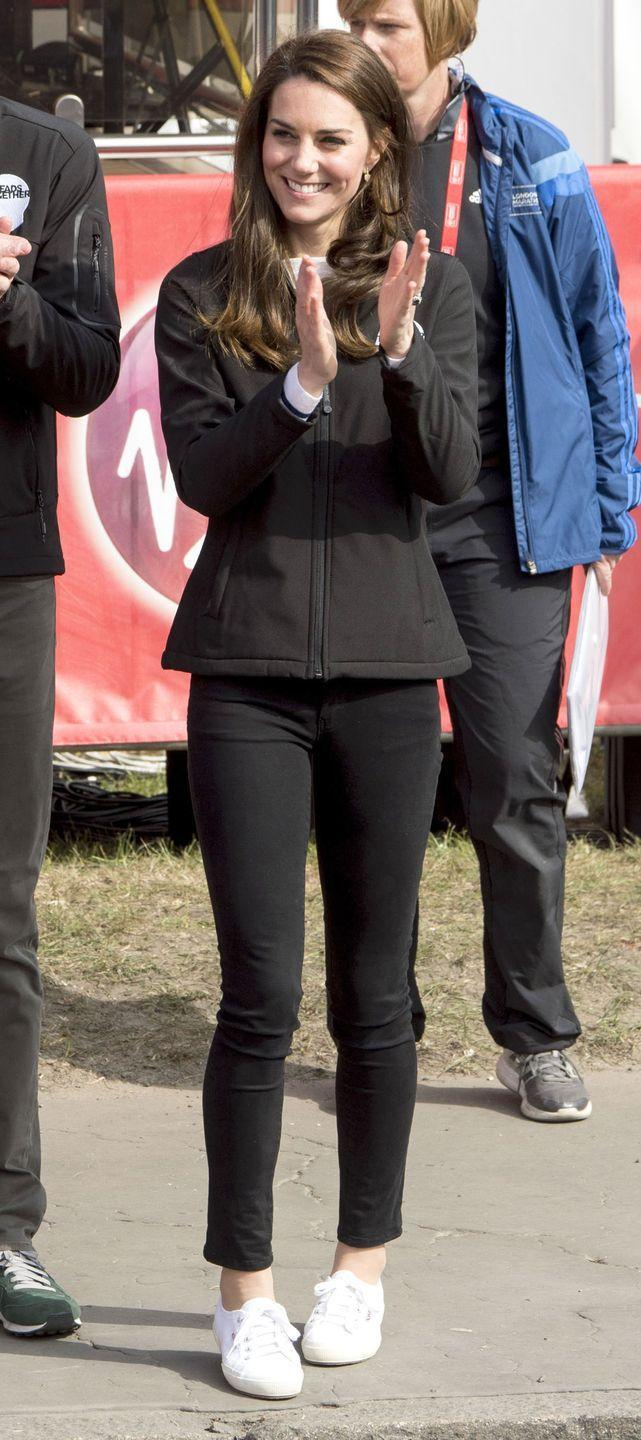 <p>In a zip-up jacket with black cropped jeans and Superga sneakers at the blue start of the Virgin Money London Marathon.</p>