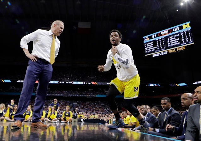 Michigan head coach John Beilein talks with guard Zavier Simpson, right, during the second half against Loyola-Chicago in the semifinals of the Final Four NCAA college basketball tournament, Saturday, March 31, 2018, in San Antonio. (AP Photo/David J. Phillip)