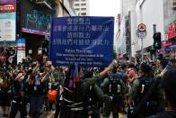 Police ask people to leave to avoid mass gathering during a protest in Hong Kong