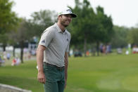 Sam Burns reacts after his putt on the 18th green during the third round of the AT&T Byron Nelson golf tournament, Saturday, May 15, 2021, in McKinney, Texas. (AP Photo/Tony Gutierrez)