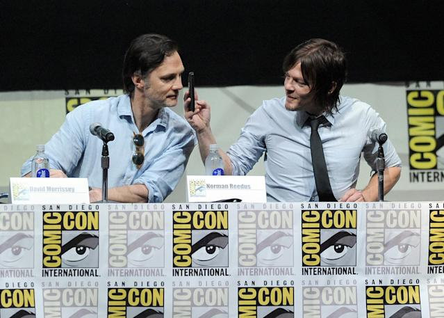 "David Morrissey and Norman Reedus speak onstage at AMC's ""The Walking Dead"" panel during Comic-Con International 2013 at San Diego Convention Center on July 19, 2013 in San Diego, California."