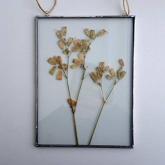 "Get it from <a href=""https://www.etsy.com/listing/582491339/pressed-flower-frame-pressed-plants?ga_order=most_relevant&ga_search_type=all&ga_view_type=gallery&ga_search_query=herbariums&ref=sc_gallery-1-11&plkey=3b556b22b74dcf1fc551cba7066fc2acf8c2442d:582491339"" target=""_blank"">Julivani on Etsy, $32</a>."