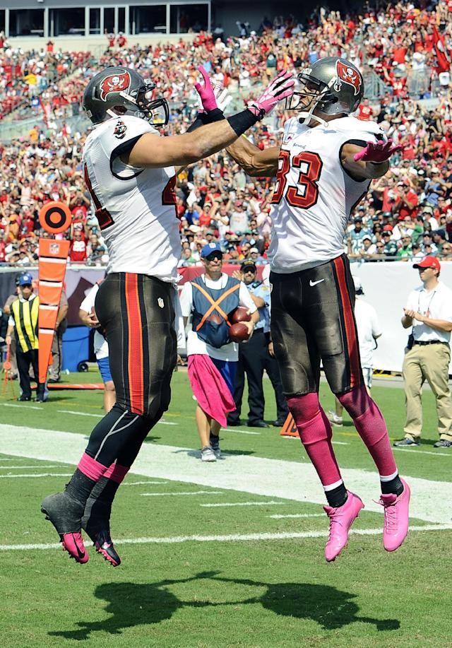 Tampa Bay Buccaneers wide receiver Vincent Jackson (83) celebrates with fullback Erik Lorig (41) after Jackson caught a one-yard touchdown reception during the second quarter of an NFL football game Sunday, Oct. 13, 2013, in Tampa, Fla. (AP Photo/Steve Nesius)