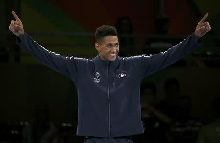 2016 Rio Olympics - Boxing - Victory Ceremony - Men's Super Heavy (+91kg) Victory Ceremony - Riocentro - Pavilion 6 - Rio de Janeiro, Brazil - 21/08/2016. Gold medallist Tony Yoka (FRA) of France reacts. REUTERS/Matthew Childs