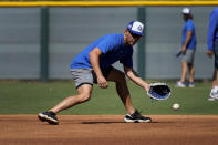 Israel Olympic baseball player Danny Valencia takes fielding practice at Salt River Fields spring training facility, Wednesday, May 12, 2021, in Scottsdale, Ariz. Israel has qualified for the six-team baseball tournament at the Tokyo Olympic games which will be its first appearance at the Olympics in any team sport since 1976. (AP Photo/Matt York)
