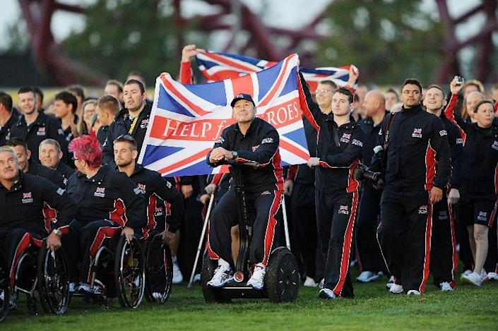 Great Britain's team parades onto the field during the opening ceremony of the Invictus Games at Queen Elizabeth II Park in London on September 10, 2014 (AFP Photo/Dave J Hogan)