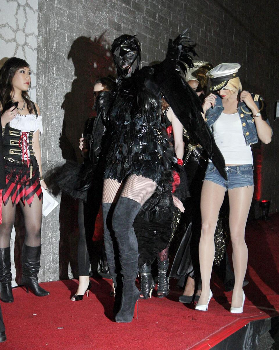 Heidi Klum dresses as a crow for her 2009 Halloween party. - Credit: PR
