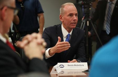Dennis Muilenburg, CEO, Boeing speaks during a roundtable discussion on defense issues with U.S. President Donald Trump at Luke Air Force Base