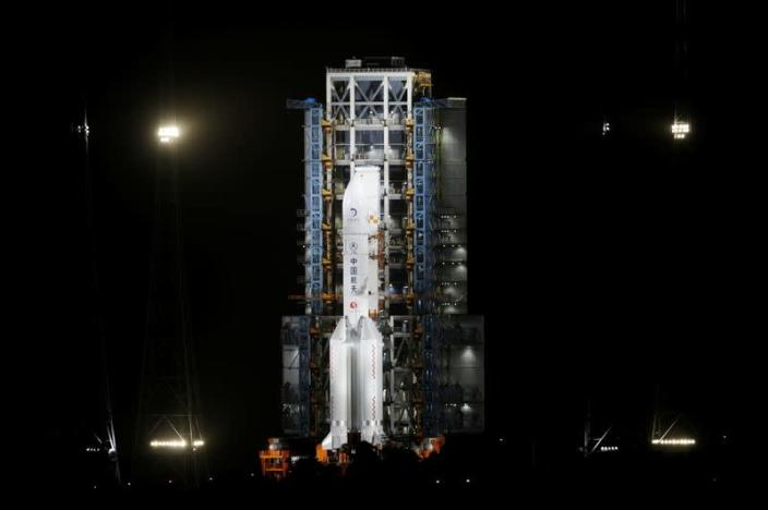 The Long March-5 Y5 rocket, carrying the Chang'e-5 lunar probe, is seen before taking off from Wenchang Space Launch Center, in Wenchang