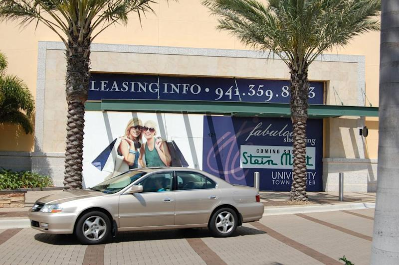 Showroom window posters announced Stein Mart's arrival in 2010 at 119 N Cattlemen Road, in University Town Center.