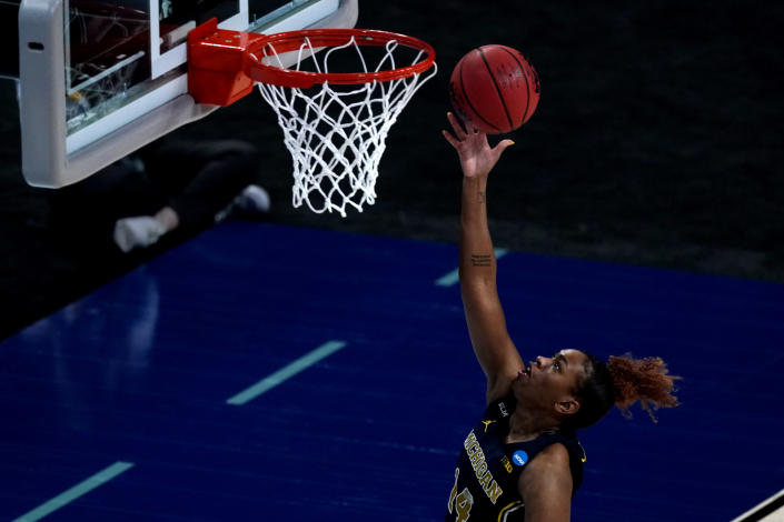 Michigan guard Akienreh Johnson shoots during the first half of a college basketball game against Tennessee in the second round of the women's NCAA tournament at the Alamodome in San Antonio, Tuesday, March 23, 2021. (AP Photo/Charlie Riedel)