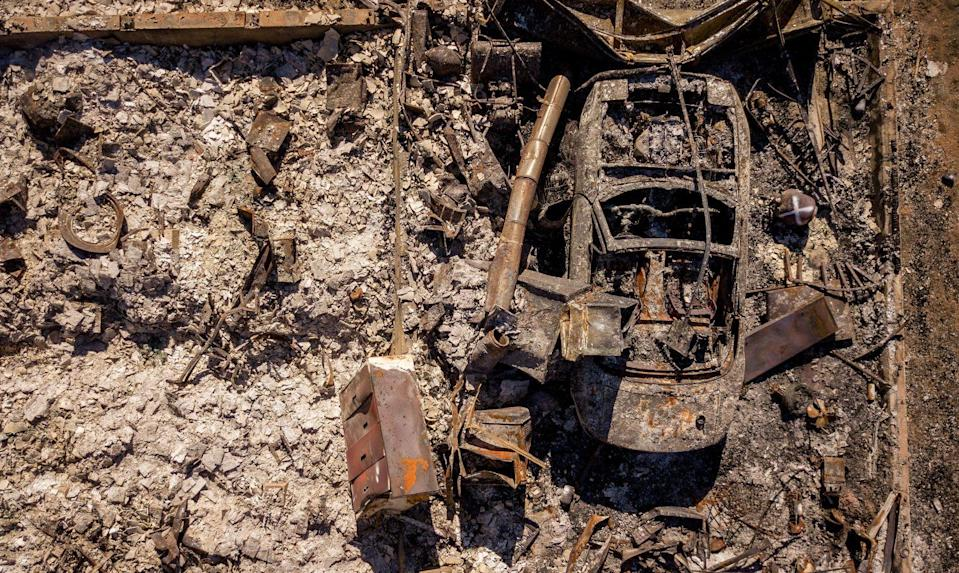 The remains of a burnt vehicle, seen from above.