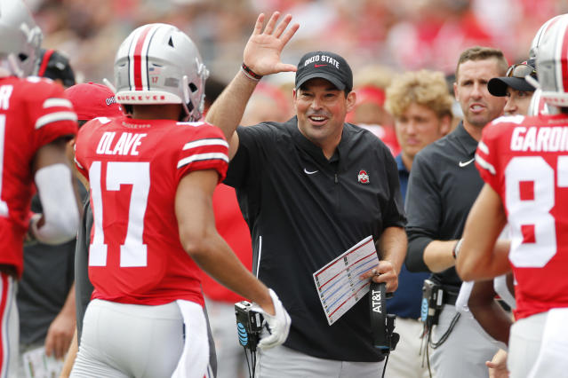 FILE - In this Aug. 31, 2019, file photo, Ohio State head coach Ryan Day, center, celebrates their touchdown against Florida Atlantic during the first half of an NCAA college football game, in Columbus, Ohio. No. 6 Ohio State knows the games are going to get harder eventually, but so far everything has just seemed, well, so easy. (AP Photo/Jay LaPrete, File)
