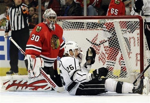 Los Angeles Kings' Slava Voynov (26) celebrates after scoring his goal as Chicago Blackhawks goalie Ray Emery (30) looks down during the first period of an NHL hockey game in Chicago, Sunday, March 11, 2012. (AP Photo/Nam Y. Huh)