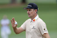 Justin Rose reacts after his birdie on the second hole during the third round of the Masters golf tournament at Augusta National, Saturday, April 10, 2021, in Augusta, Ga. (Curtis Compton/Atlanta Journal-Constitution via AP)