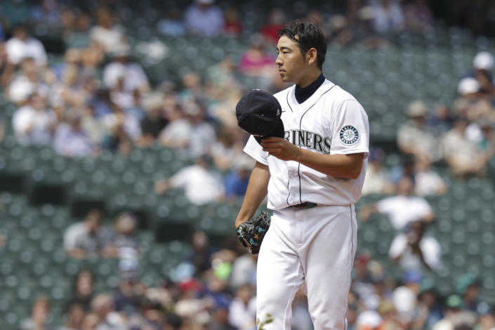 Seattle Mariners starting pitcher Yusei Kikuchi communicates with catcher Tom Murphy during the fourth inning of a baseball game against the Houston Astros, Wednesday, July 28, 2021, in Seattle. (AP Photo/Jason Redmond)