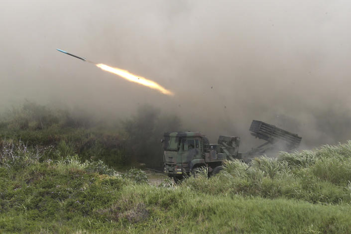 A rocket is fired from a Thunderbolt 2000 multi-rocket launcher during the 36th Han Kung military exercises in Taichung City, central Taiwan, Thursday, July 16, 2020. Taiwan's military fired missiles from the air and the island's shore facing China on Thursday in a live-fire exercise to demonstrate its ability to defend against any Chinese invasion. (AP Photo/Chiang Ying-ying)