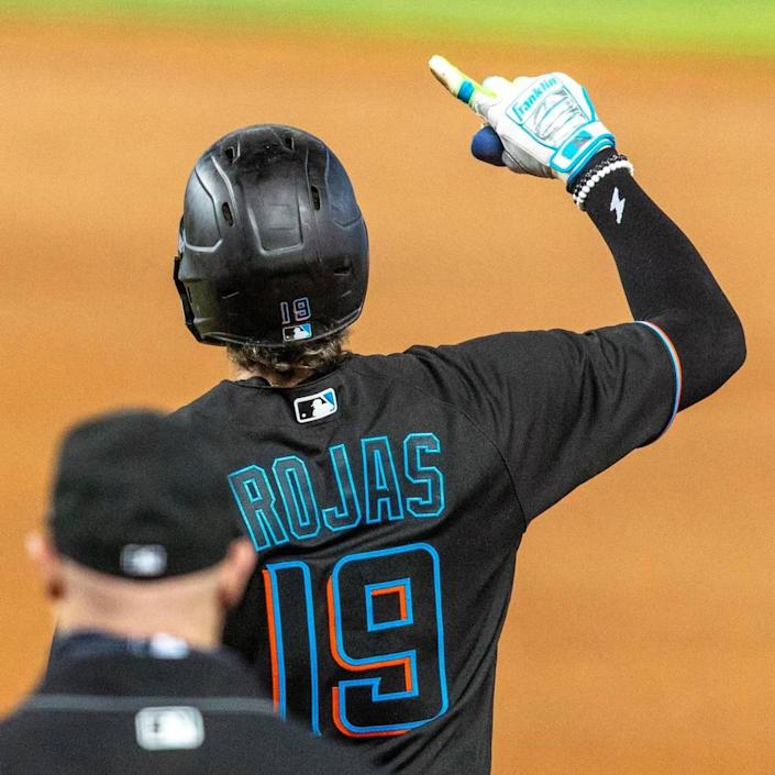 Miami Marlins shortstop Miguel Rojas(19) reacts after hitting a line drive to center field during the first inning of an MLB game against the Milwaukee Brewers at loanDepot park in the Little Havana neighborhood of Miami, Florida, on Friday, May 7, 2021.