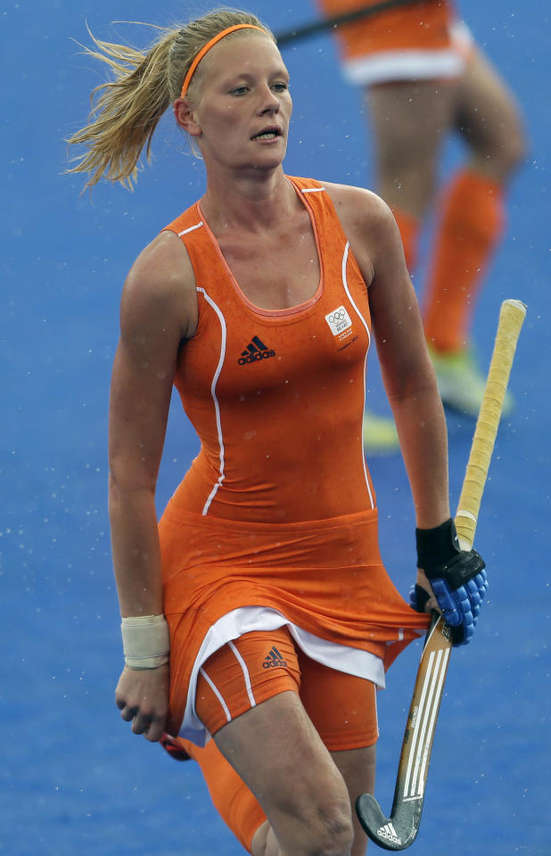The Netherlands' Caia van Maasakker adjusts her jersey after scoring the third goal for her country in the women's hockey preliminaries against Belgium at the 2012 Summer Olympics, Sunday, July 29, 2012, in London. (AP Photo/Bullit Marquez)