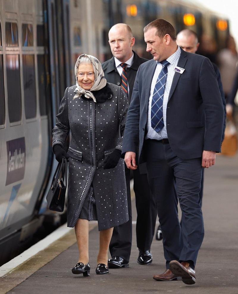 Queen Elizabeth II boards a train at King's Lynn Station to return to London after her Christmas break at Sandringham House, February 2016.