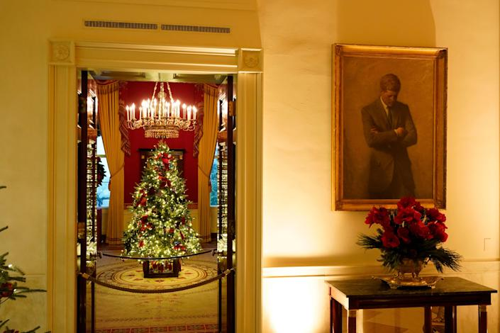JFK's portrait hangs outside the Red Room of the White House, but this year the image is also on Christmas tree decorations in the Vermeil Room (AP)
