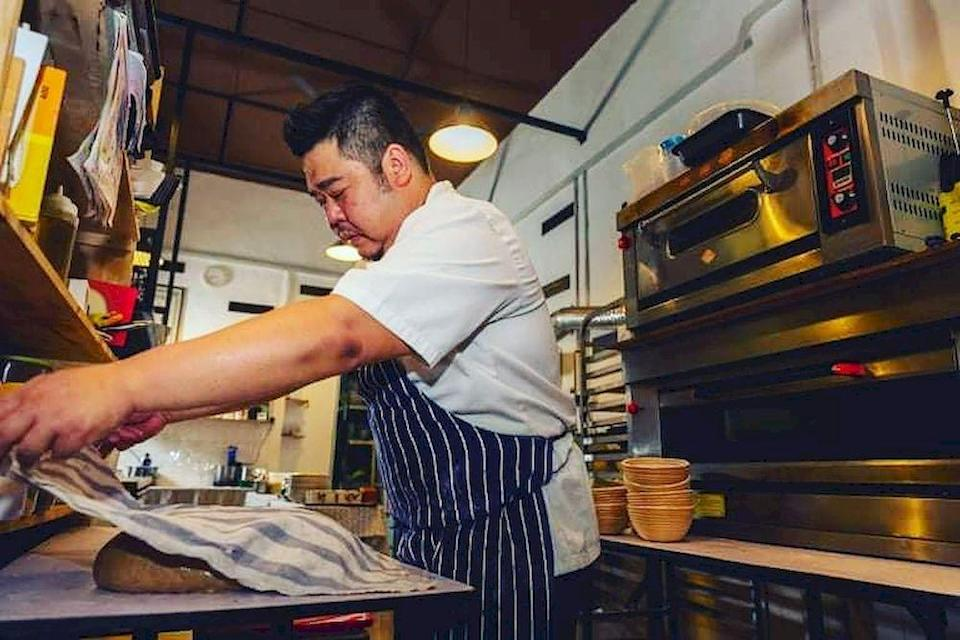 Artisan Handmade Bread's Sam Lau bakes up wholemeal and rye sourdough breads in Ipoh — Photo courtesy of Artisan Handmade Bread's Facebook page