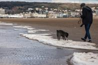 <p>The shoreline waters at Weston-super-Mare in Somerset froze over as the Beast from the East moved in. Ian, 48, said: 'I was out walking along the seafront with my partner Calin and we could see a long white line at the high water line. (SWNS) </p>