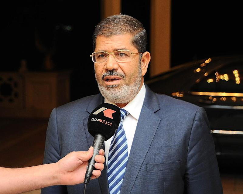 Former Egyptian President Mohamed Morsi speaks to Egyptian Television ahead of an emergency meeting at the presidential palace in Cairo on August 5, 2012