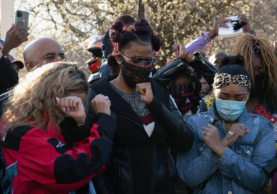 """<p>His loved ones put up their """"X"""" signs as they shed tears and prayed for Simmons.</p>"""
