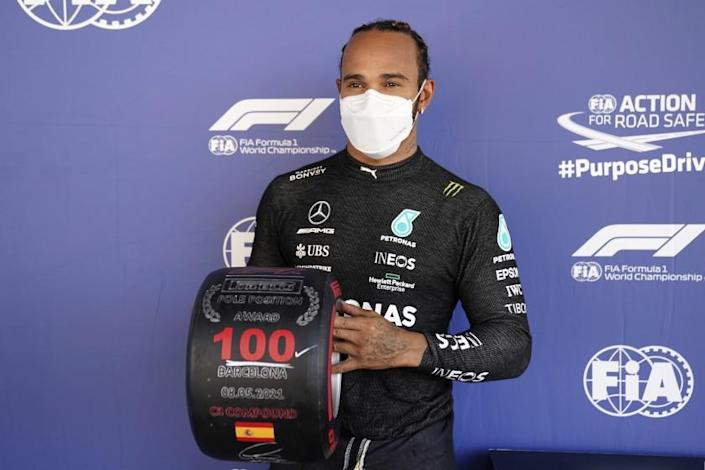 Mercedes driver Lewis Hamilton of Britain poses after he clocked the fastest time in the qualifying for the Spanish Formula One Grand Prix at the Barcelona Catalunya racetrack in Montmelo, just outside Barcelona, Spain, Saturday, May 8, 2021. The Spanish Grand Prix will be held on Sunday. (AP Photo/Emilio Morenatti, Pool)