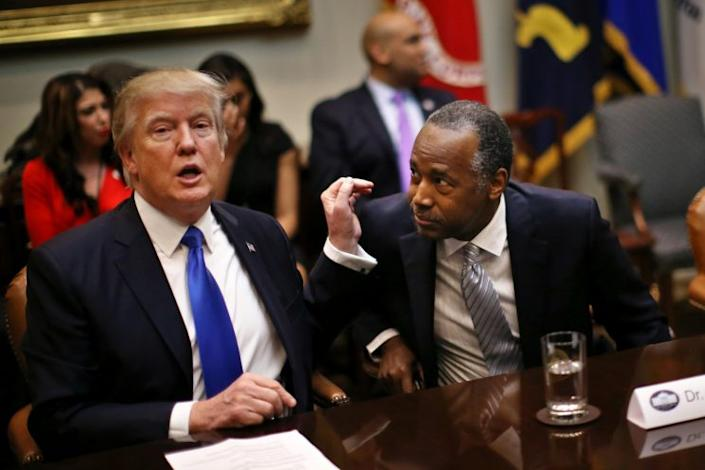 President Trump attends an African-American History Month listening session with Housing and Urban Development Secretary Ben Carson in the White House on Wednesday. (Carlos Barria/Reuters)
