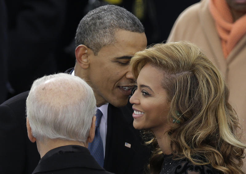 President Barack Obama talks to Beyonce before she sings the National Anthem at his ceremonial swearing-in at the U.S. Capitol during the 57th Presidential Inauguration in Washington, Monday, Jan. 21, 2013. (AP Photo/Evan Vucci)