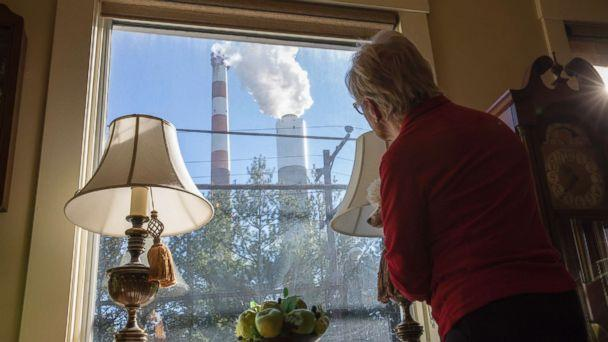 PHOTO: Marti Blake looks out her front window at the smoke stack of the 47-year old Cheswick coal-fired power plant, Oct. 27, 2017 in Springdale, Pa. (Robert Nickelsberg/Getty Images, FILE)